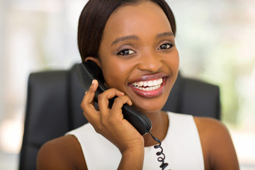 young african office worker using telephone