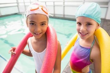 Cute little girls smiling poolside