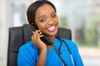 african medical doctor talking on telephone