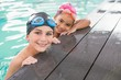Cute swimming class in the pool - 72334351