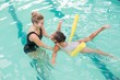 Cute little girl learning to swim with coach - 72334365