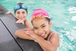 Cute swimming class in the pool - 72334373