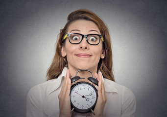 woman with alam clock anticipation time passing concept
