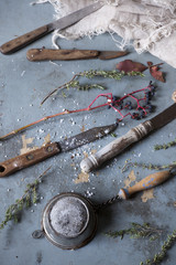 old used kitchen knives and vintage strainer on rustic table
