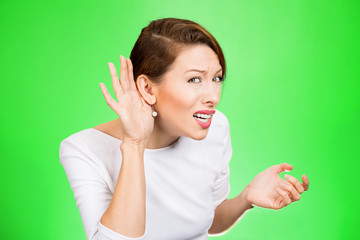 hard of hearing woman asking to speak up on green background