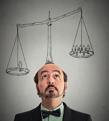 businessman with scale above head
