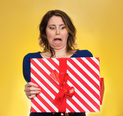 woman opening gift box upset disgusted at what she received