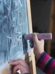 Child writing chalk