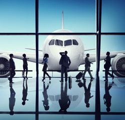 Silhouette Group of Business People with Airplane