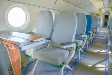 Interior of an airplane with many seats