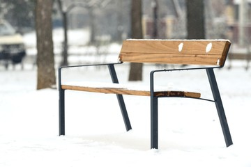 Wooden bench at winter