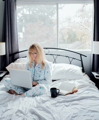 Businesswoman Working in Bed