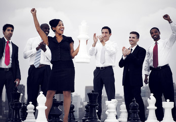 Business People Celebration Winning Chess Game
