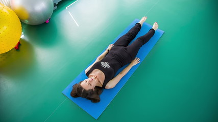 Healthy Woman Practicing Yoga On a Mat