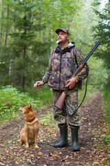 Man with dog out hunting for hazel grouse