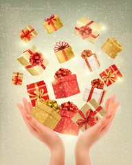 Christmas gold background with gift boxes and hands. Vector illu