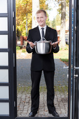 Canvasser selling stainless pot