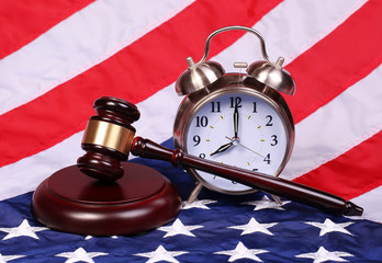 Judge Gavel and Alarm Clock over American Flag