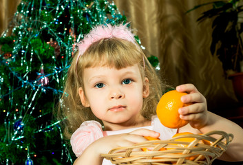 Girl with tangerines in Christmas