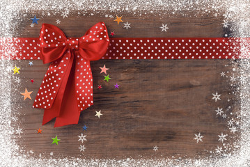 Winter background with a bow