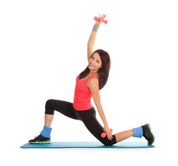 Attractive young female with fitness dumbbells in stretching