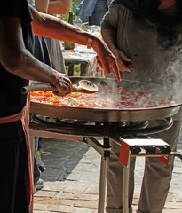 preparation of Spanish paella at a party picnic
