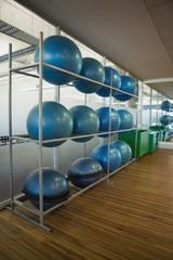 Exercise balls on rack in studio