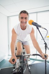 Spinning instructor smiling at camera