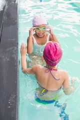 Cute little girls in the swimming pool