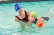 Cute little boy learning to swim with coach - 72351569
