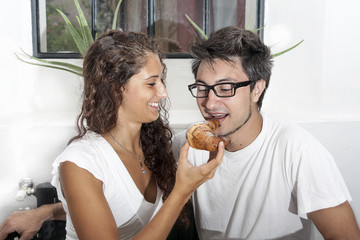 teenage couple has breakfast at home