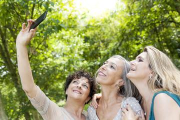 ladies take a selfie in the wood