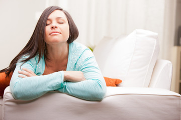relaxed woman thinking on her sofa
