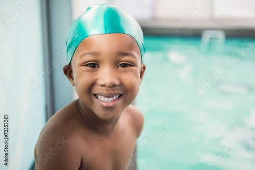 Cute little boy smiling at the pool - 72353301