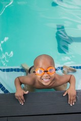 Cute little boy smiling up at the pool