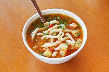 laghman soup in white bowl