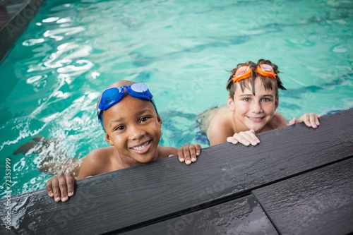 Little boys smiling in the pool - 72353999
