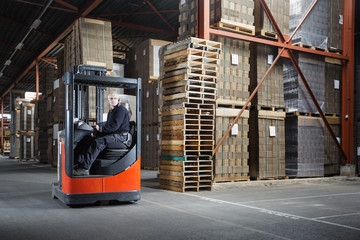 Reach truck driver in a warehouse