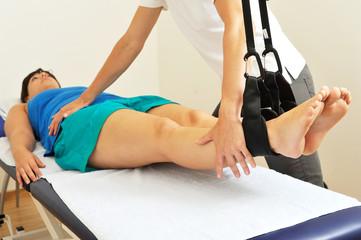 Osteopathische Behandlung auf Schlingentisch