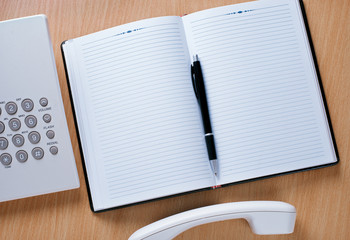 Telephone Officer Work Area with Notebook and Pen