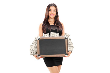 Woman holding a briefcase full of money