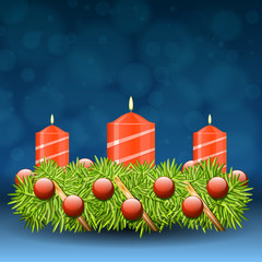 Advent wreath of twigs with red candles and various ornaments