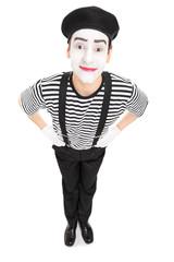 Vertical shot of a joyful mime artist