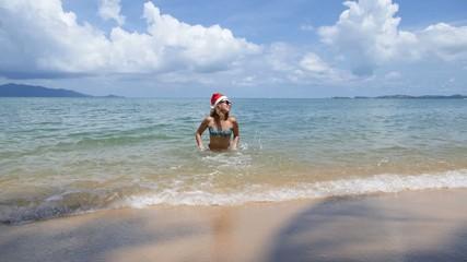 Happy Woman on Beach in Santa Hat on New Year Celebration. Slow