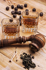 Smoking pipe tobacco a glass of whiskey in vintage style