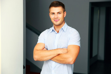 Portrait of a handsome man with arms folded