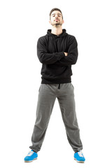 Confident young man in sportswear