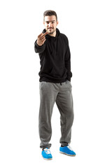 Young man in hoodie with middle finger gesture