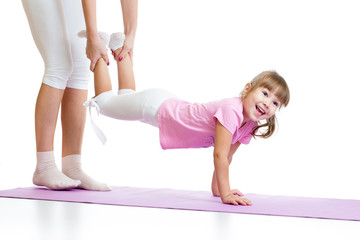 kid girl doing gymnastic and standing on her hands