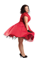 portrait of beautiful plus size brunette in polka dot dress